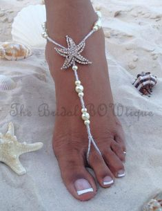 NEW DESIGN - Starfish pearls barefoot sandals.This pair of pearl barefoot sandals is simple, yet very elegant. It is made with a combination of ivory pearls and clear AB beads and is decorated with a starfish. Will be perfect for your beach wedding or a destination wedding. The bridal pair comes in white or Ivory. The pair shown here is made with ivory pearls and starfish has some gold accents. Want matching pairs for your bridesmaids in your wedding colors? I can custom make these…