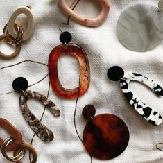 The Outlier Jewellery The Outlier Jewelry Acrylic resin minimalist handmade earrings jewellery jewelry. Tortoise shell, wood, hand poured The Pistil earring The Helicene earring The Loot earring