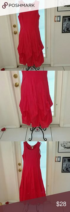 NWT sleeveless dress with a flared skirt. This is a very pretty dress that can be worn 2 ways. The skirt can be long and flared, or the hem can be tied by attached strings into a bubble hem dress. The color is Teaberry,  95% cotton and 5% spandex. XL.  Holiday Sale 15% off! Now $22.00 Vasna Desire Dresses Maxi