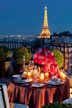 elegant table on a balcony overlooking Paris