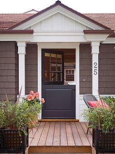 Love this high contrast Dutch Door against white molding, columns with large address numbers and softer hued house facade. Makes for a welcoming first impression and fresh curb appeal. BHG.