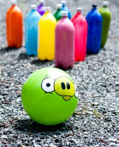 Angry Birds Bowling - empty soda bottles, painted on the inside, make colorful bowling pins. The pig bowling ball is actually a playground ball with a hand-painted Angry Birds pig.