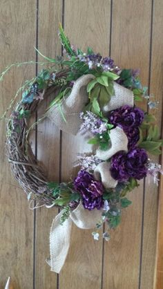 Wreath with Ivy, purple flowers, Burlap and a touch of gems