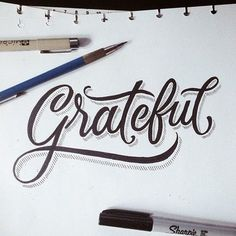 Hand lettering with a drop shadow.