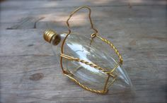 How to turn a chandelier bulb into a vase with a muselet (wire from a champagne cork)