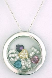 'What's in Your Heart' pendant. Initials/symbols of choice enclosed in framed glass circle. They can move around within the space.
