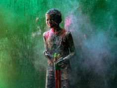 colored powder during Holi celebrations in Chennai.