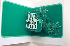 Sizzix Die Cutting Inspiration and Tips: Pop 'N Cuts card by Jan Hobbins using the Pop n Cuts base with Tim Holtz Holiday Wreath, Festive Greenery and Stacked wrods: Christmas dies. Pop Up Christmas Cards, Christmas Pops, Christmas Paper Crafts, Xmas Cards, Holiday Cards, Flip Cards, 3d Cards, Pop Up Cards, Origami Cards
