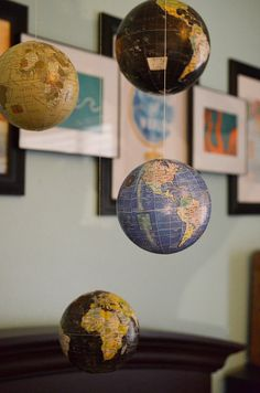 Globe mobile. Travel inspired nursery. Oh. My. Goodness. Why are there so many CUTE ideas and only one nursery?!