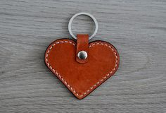 Hey, I found this really awesome Etsy listing at https://www.etsy.com/listing/231833548/leather-heart-keychain-brown-and-white