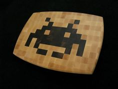 This hand-made pixel art cheese board is an homage to the awesome video games of the 70s and 80s. The piece is a solid wood, end-grain cutting