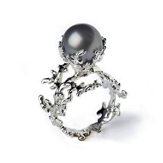The unique Coral Pearl Ring is part of a collection inspired by the living sculptures of corals. A large top quality grey-black genuine Tahitian pearl is