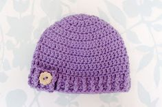 Premie size here .  Newborn size here .  3 month size here .   This hat can be girly, too! With a simple vintage-look flower button, t...