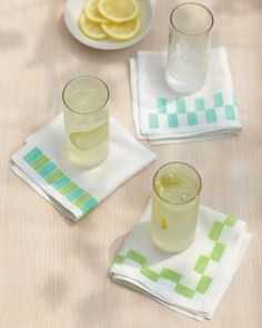 Fabric Napkins with Stamped Borders - With simply an eraser and fabric paint, you can give some plain-Jane napkins a little personality. Stamp a bright border in any pattern and palette you fancy.