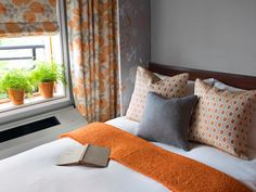 See how pumpkin spice (HGTV's November Color of the Month!) and gray accents can liven up a small guest room at HGTV.com. (http://photos.hgtv.com/photo/gray-and-orange-guest-room?soc=Pinterest)