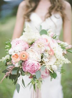 Pink ranunculus and pink cabbage roses: http://www.stylemepretty.com/2015/04/14/20-pastel-bouquets-for-the-bride/