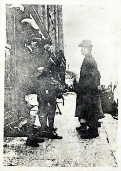 Elizabeth O'Farrell is obscured by Patrick Pearse,only her feet and skirt hem are visible.