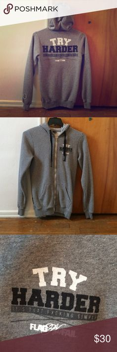 FNF Try Harder hoodie Only worn once! FNF fitted zip up sweatshirt. Really like this hoodie, just don't find myself wearing it all that much. In excellent condition! Grey hoodie with black and white type. Unisex size S. Will fit a women's S-M or a men's S. Fits snug! Flag Nor Fail Tops Sweatshirts & Hoodies