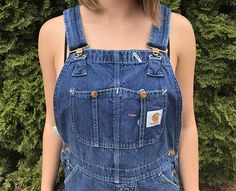 Vintage Carhartt overalls, union made in the USA. 100% cotton denim, medium blue wash. 2 front chest pockets with copper snaps. Square Carhartt tag on the chest. Adjustable shoulder straps with copper hardware. 2 front hand pockets, 2 rear pouch pockets. Utility pocket on the right leg, hammer loop on the left leg. 2 buttons on each side. Button fly.  Very good condition! No holes, tears, slight stains on the kness.  Size tag is unreadable. Actual measurements are... Waist - 34 Inseam - 28…