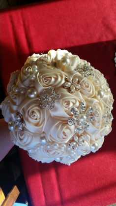 Detail on the personal touches chose from the bride's Custom handmade brooch bouquet. Black tie Christmas wedding. Hyatt Arcade, Downtown Cleveland, OH. Copperlight Live Events