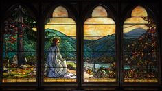 """The stained glass windows of All Saints Episcopal Church, Great Neck, NY include four Tiffany windows, of which this is one being a  rendition of Psalm 121, """"I will lift up mine eyes unto the hills from whence cometh my strength."""""""
