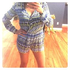 Tribal print romper! Blue and green tribal print romper! Long sleeve with cuffed buttons and a snap in the front closure so your boobs don't bulge out if you don't want them too. Pants Jumpsuits & Rompers