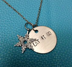 """Hand Stamped """"Let it Go"""" Disc Necklace or Key-Chain (with optional snowflake) by ThePaperPoppyStore on Etsy https://www.etsy.com/listing/183024428/hand-stamped-let-it-go-disc-necklace-or"""