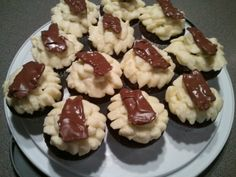 Chocolate Covered Bacon sprinkled w/ Sea Salt over a Basic Buttercream Icing topping a Chocolate Cupcake