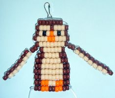 Pony bead owl key chain holder.