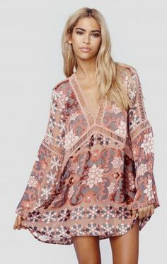 The For Love and Lemons Juliet Mini Dress is simply stunning with the brand's signature floral print throughout, mini ladder cut-out trim, long bell sleeves, and a flowing body.