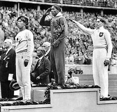 Jesse Owens after receiving gold medal for the long jump. Take that Hitler!