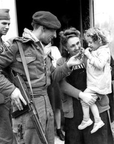 French villagers welcome French Naval Commandos who arrived in Normandy during the D-Day landings. The Naval Commandos were formed by Free French troops in exile in the U.K. and were modeled after the British Commandos, who were founded in 1940. They were formed from Free French Navy Fusiliers-Marins (naval infantry) and trained at the Commando Basic Training Centre Achnacarry, Scotland. Near Amfreville, Calvados, Lower Normandy, France. 17 June 1944.