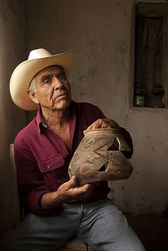 Juan Quezada of Mata Ortiz, Chihuahua, Mexico with a piece of ancient Paquime pottery from nearby Casas Grande which inspired him as a young man to revive the ancient art which in turn led to his village becoming a a center of fine pottery making.