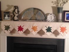 http://www.quiltingboard.com/pictures-f5/just-time-t257402.html PUT UP A SHELF UNDER BIG MIRROR IN LIVING ROOM! MAKE DIFF/SEASONAL MANTEL RUNNERS.