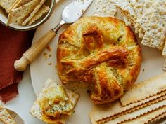 Holiday appetizers have met their match with this spinach artichoke baked brie. The crispy puff pastry encases a layer of creamy spinach and melty brie, making the perfect mashup. Spread onto your favorite crackers or crostini and enjoy all season long. Holiday Appetizers, Appetizer Dips, Appetizer Recipes, Holiday Recipes, Yummy Appetizers, Christmas Recipes, Wedding Appetizers, Burger Recipes, Christmas Goodies
