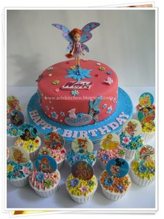 """Winx Club Theme  9"""" round cake(approx 20-22pax)and 18pcs of cupcakes.  Note: Winx Club topper provided by customer."""