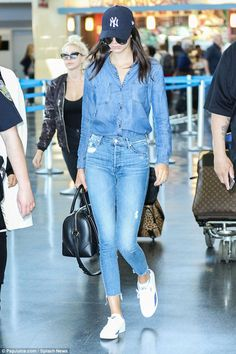 Casual customer: Kendall went for a double denim look, tucking her jean blouse into her di...