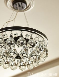 LOVE the glass baubles on this light fixture! - Traditional Home ®/ Photo: John Merkl / Design: Cathleen Gouveia