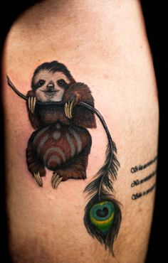 "Sloth hanging on a peacock feather  ""Nick Hart @ Deep Roots Tattoo in Seattle, WA"""