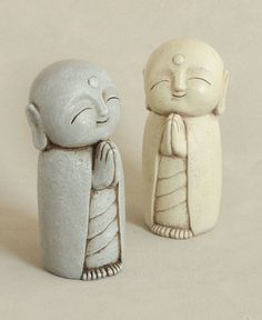 Antique inspired garden statue depicts beloved bodhisattva, Jizo, one of the most popular Buddhist figures. 8 inches. Multiple colors available.