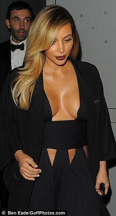 Blondes have more fun: The reality star Kim Kardashian wore a wine colored lipstick with her blond hair and tan skin