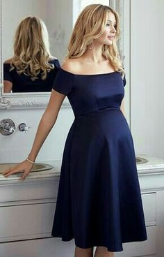 The ultimate occasion dress for maternity glamour Aria is simply breathtaking in our rich new navy satinesque fabric. Channelling starlet beauty with a Bardot neckline that sits just off the shoulder and a sleek skirt that falls perfectly at the knee. Stylish Maternity, Maternity Wear, Maternity Dresses, Maternity Fashion, Maternity Wedding, Maternity Style, Maternity Photos, Tiffany Rose, Dresses For Pregnant Women