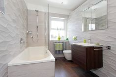 Duravit Delos furniture working beautifully with stunning Porcelanosa tiles.