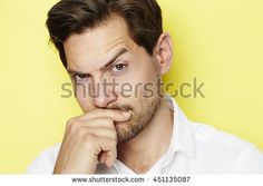 Quizzical man raising eyebrow, portrait
