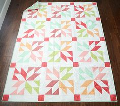 Lucky by Camille Rosekelly.  How cool: half square traingles; 4 per color and 4 per block.  Super Easy & super fast.....need to add this to my list.