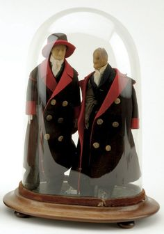 """late 19th century, pair of wax headed dolls on leather bodies, dressed in original brown and red wool coats with detailed underclothing Size: dolls 10.5"""" t."""