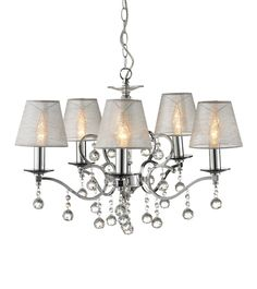 Add a touch of class to your home with a classic crystal, brass, gold or antique chandelier. Dar Lighting, Ceiling Lights, Crystal Chandelier, Wagon Wheel Chandelier, Lights, Statement Lamp, Light, Chandelier, Chandelier Shades
