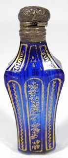 Vintage Bristol blue cut glass scent bottle with gilded decoration and embossed silver metal mount