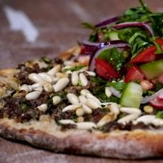 Lahmacun – Turkish pizza with spicy minced beef and salad topping
