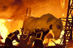 """I love the photo and I love Mike's caption. """"It's not every day you see firemen pushing a unicorn into the flames, but this is Las Fallas, an annual celebration of burning things for fun, in Valencia, Spain. Celebrated every Saint Joseph's day. For more information, check out http://en.wikipedia.org/wiki/Las_Fallas. """"    Photo ©Mike Randolph"""